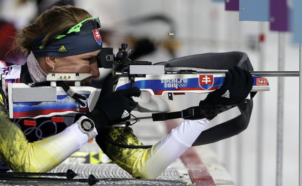 Slovakia's Anastasiya Kuzmina shoots on her way to win the gold medal in the women's biathlon 7.5k sprint Sunday at the 2014 Winter Olympics in Krasnaya Polyana, Russia.