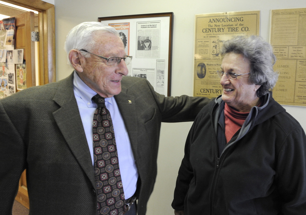Longtime customer Penny Carson says goodbye to Dick Aronson, owner of Century Tire.