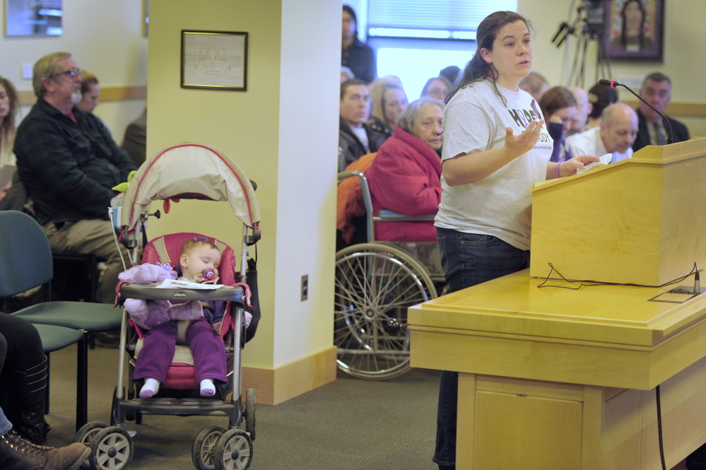 Meagan Patrick, who brought her daughter Addelyn to the hearing, appeals to Maine lawmakers on the Health and Human Services Committee to allow a marijuana derivative to help with her child's epilepsy. The public hearing Tuesday in Augusta focused on a bill that would prohibit the sale of kief, a marijuana derivative.