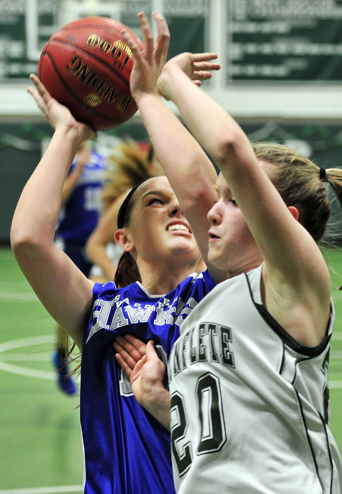Sacopee Valley's Dakota Miner gets a shot off and gets fouled by Waynflete's Arianna Giguere in Tuesday night's Western Class C girls' basketball prelim in Portland. The Flyers advanced.