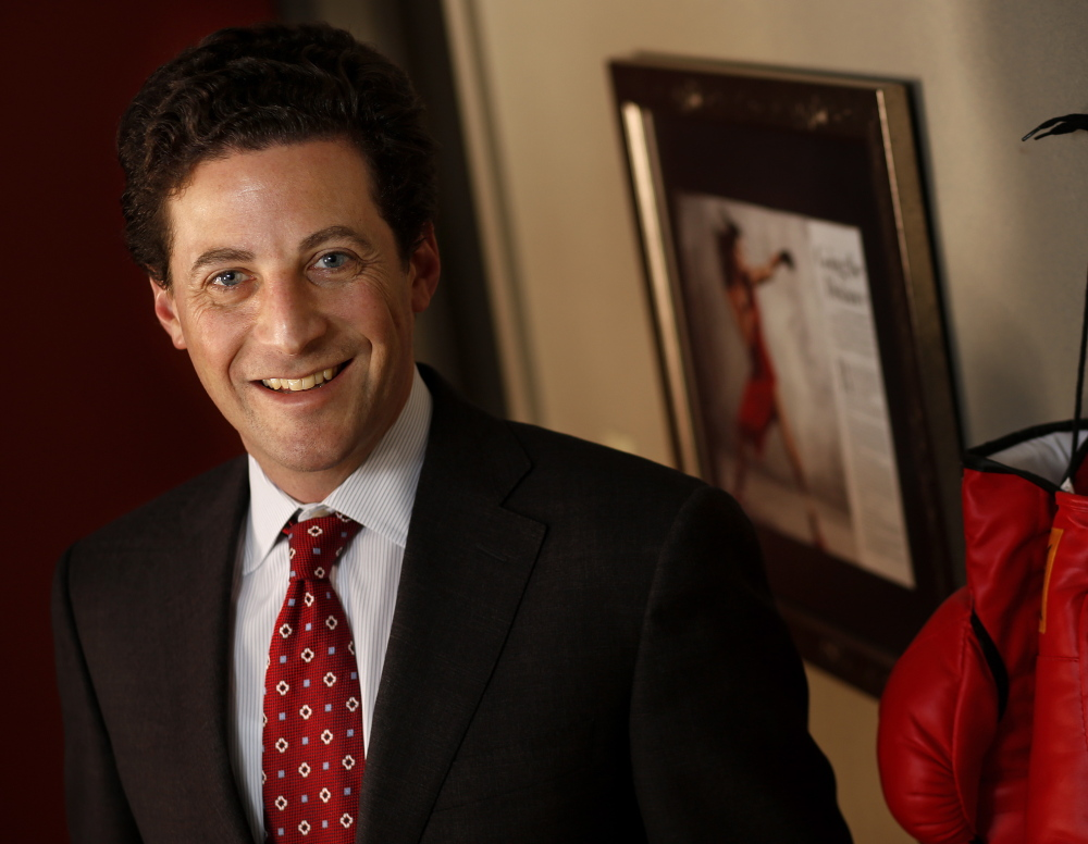 Paul Greene, shown in his Portland office, is a former TV sportscaster who began a second career as an attorney.