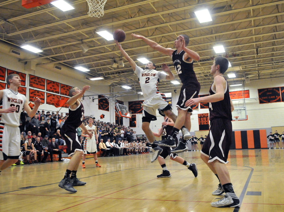 Staff photo by Michael G. Seamans HIGH SCHOOL BASKETBALL: Winslow High School's Nason Lanphier, 2, drives to the basket as Foxcroft Academy's Kolby Kendall, 42, tries to defend in Winslow on Wednesday.