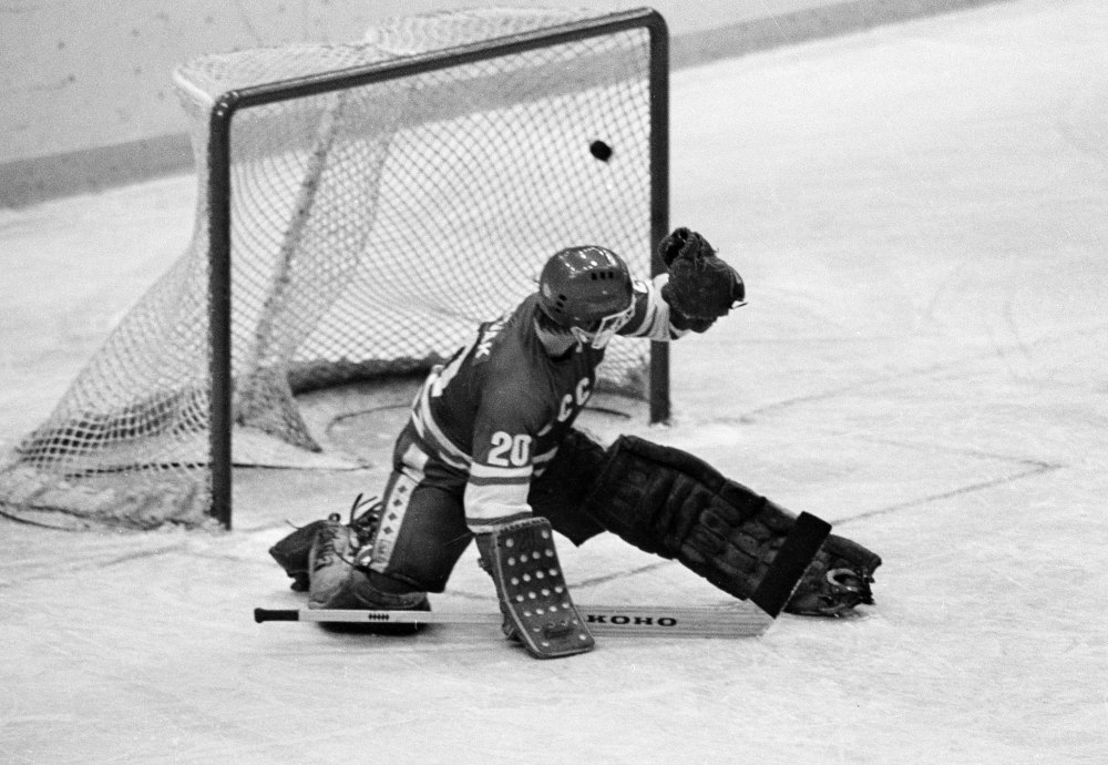 FILE - In this 1980 file photo, Soviet goalie Vladislav Tretiak allows a goal by the U.S. team in the first period of a medal-round hockey game at the 1980 Winter Olympics in Lake Placid, New York.