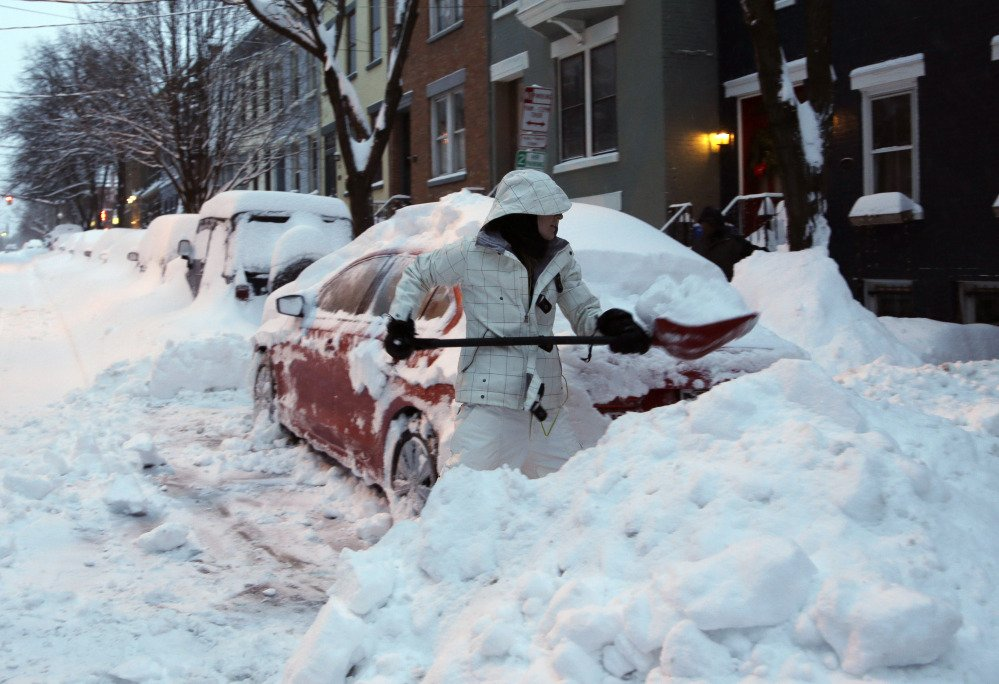 Liz Hall, of Albany, N.Y., digs her car out of snow in the Center Square neighborhood on Friday. Schools are closed across a swath of eastern New York from the mid-Hudson Valley to the Albany area as the region starts to dig out from 12 to 20 inches of snow dumped by the latest winter storm.