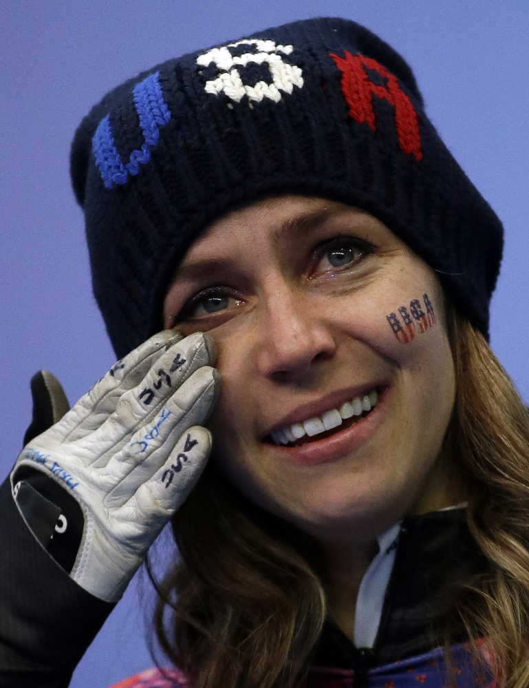 Noelle Pikus-Pace of the United States cries during the flower ceremony after winning the silver medal during the women's skeleton competition at the 2014 Winter Olympics.