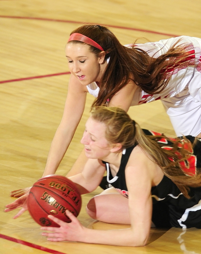 Cony's Bayleigh Logan, top, and Brunswick's Anna Dimick hit the deck for a loose ball during a Class A East quarterfinal game won by Cony at the Augusta Civic Center on Friday.
