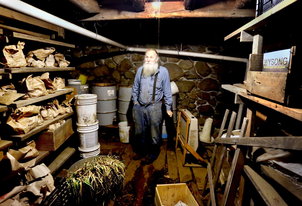 Will Bonsall stands in the root cellar of his farm in Industry where he stores hundreds of varieties of potatoes in paper bags. Highly regarded by the growing international community of seed savers, the curator still believes in growing and harvesting the seed he preserves, saying a potato needs to live in the ground in order to keep living and evolving.