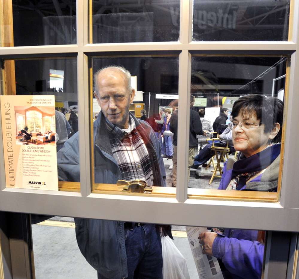 "Wayne and Debra Cilley of Waterboro shop for new windows during the Maine Home, Remodeling and Garden Show at the Cumberland County Civic Center in Portland on Saturday. ""We are gathering information and hope to be able to gather some estimates,"" she said."