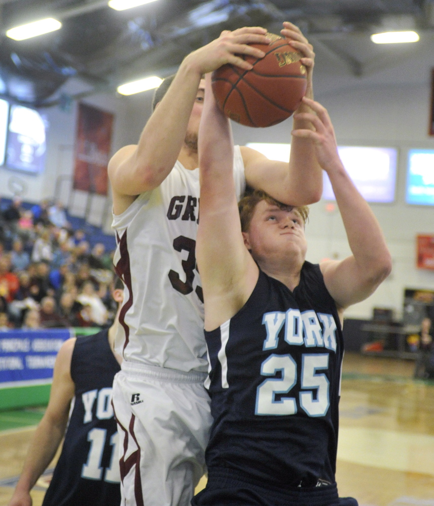 Nicholas Darby, right, of York and Mike McDevitt of Greely fight for a rebound during Greely's 41-38 win Saturday in a Western Class B boys' basketball quarterfinal at the Portland Expo.