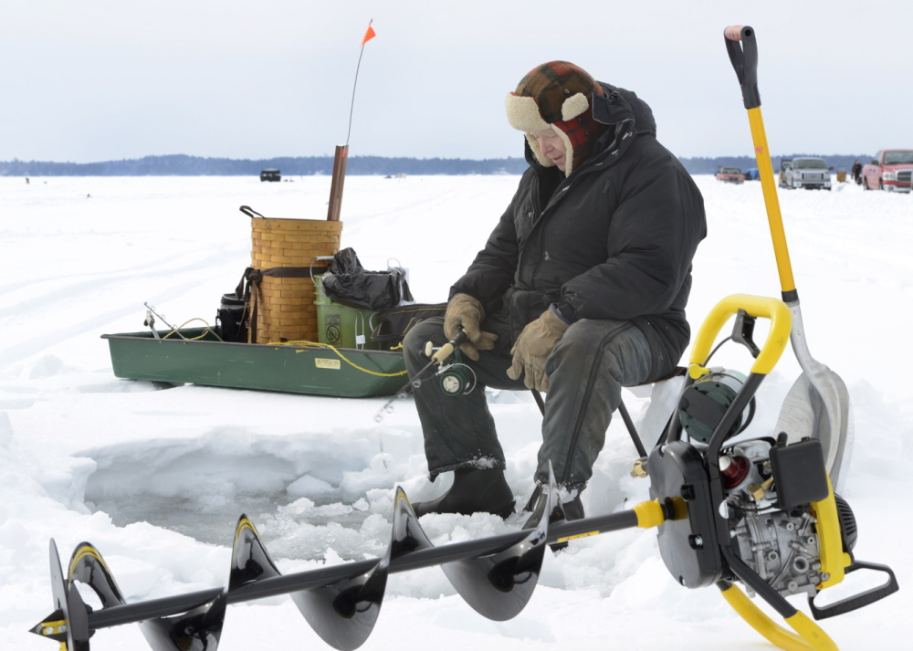 Paul St. Clair from Auburn jigs for togue as a veteran angler at the Sebago Lake Region Ice Fishing Derby on Saturday.