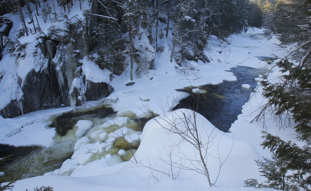 Snow and ice dominate the West Branch of the Pleasant River as it runs through Gulf Hagas near the Little Lyford Pond Camps. The 2004 purchase of Little Lyford Pond Camps by the Appalachian Mountain Club was part of its Maine Woods Initiative.