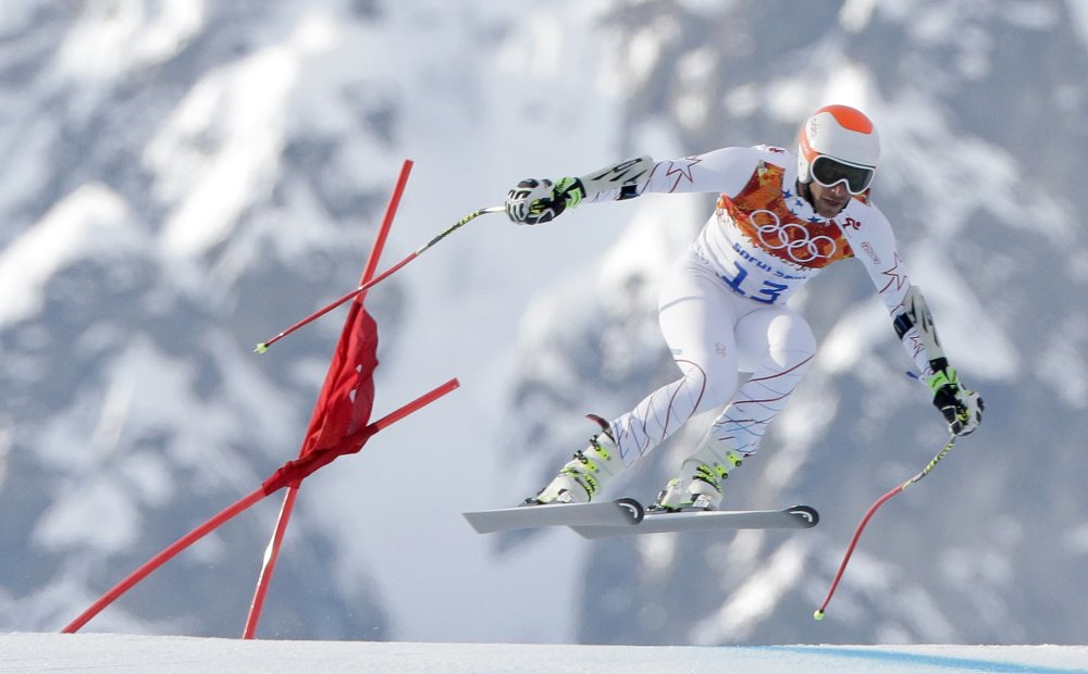 Joint bronze medal winner Bode Miller of the United States makes a jump in the men's super-G at the Sochi 2014 Winter Olympics on Sunday at Krasnaya Polyana, Russia.