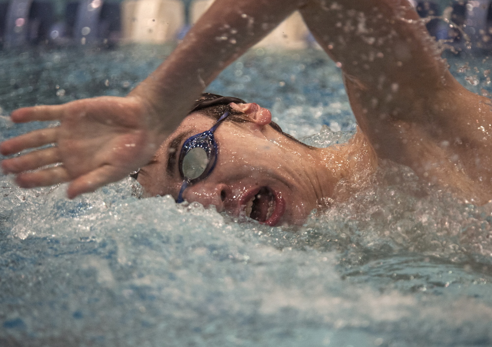 Michael O'Donovan of Cheverus heads toward a second-place finish in the 200-yard freestyle at the Class A boys' swimming and diving championships Monday at the University of Maine. O'Donovan anchored Cheverus to victory in the final event – the 400 freestyle relay – to enable the Stags to clinch the team championship.