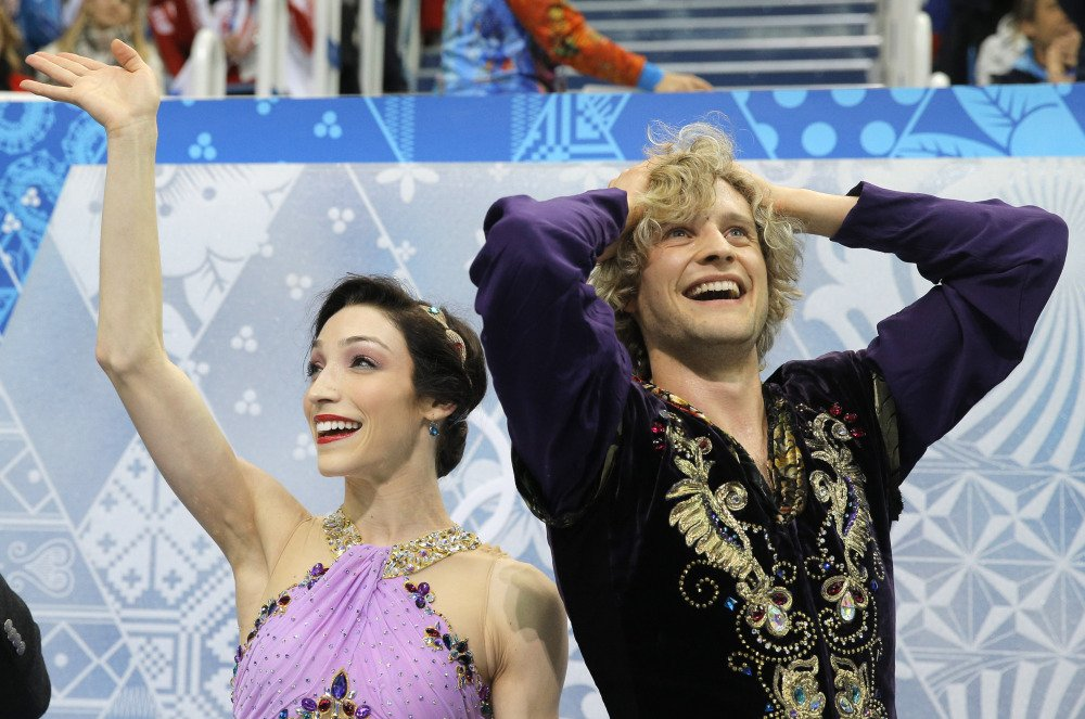 Meryl Davis and Charlie White of the United States react in the results area after competing in the ice dance free dance figure skating finals at the Iceberg Skating Palace during the 2014 Winter Olympics, on Monday in Sochi, Russia.