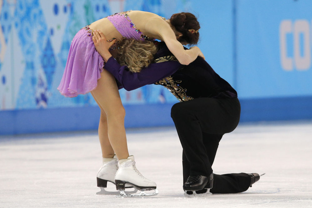 Meryl Davis and Charlie White of the United States embrace after completing their routine in the ice dance free dance figure skating finals at the Iceberg Skating Palace during the 2014 Winter Olympics on Monday in Sochi, Russia.