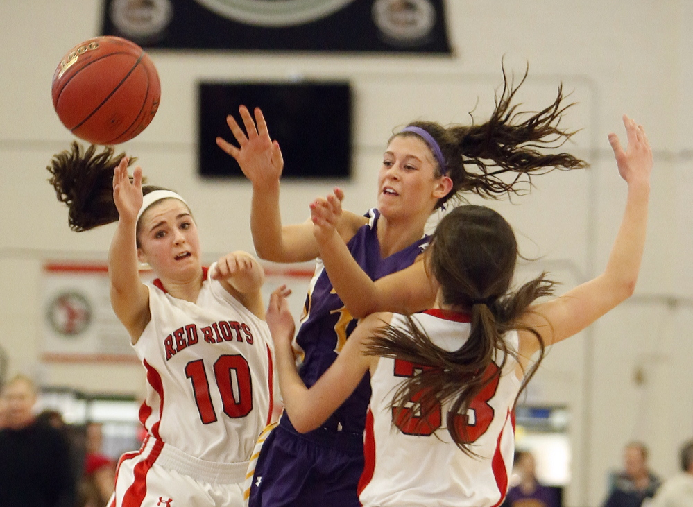 Jill Libby of Cheverus tries to thread the ball through Lydia Henderson, left, and Maddie Hasson of South Portland during their Western Class A girls' basketball quarterfinal Monday afternoon at the Portland Expo. Cheverus won, 61-42.