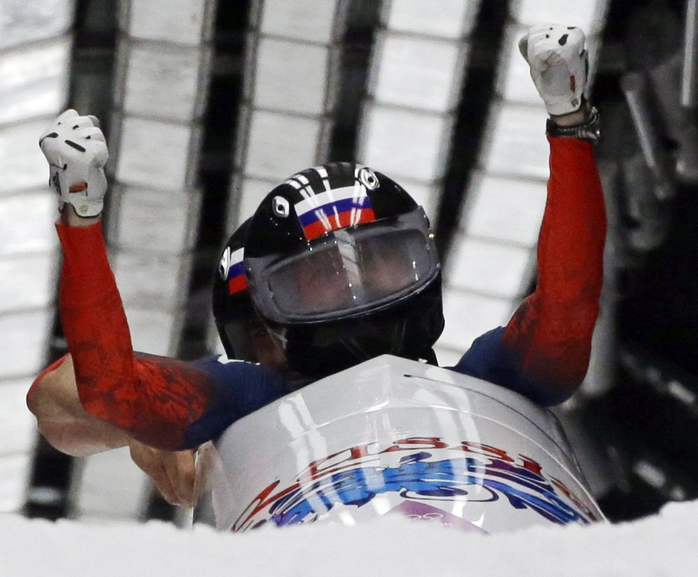 The Associated Press The team from Russia RUS-1, piloted by Alexander Zubkov and brakeman Alexey Voevoda, cross into the finish area to win the gold medal during the men's two-man bobsled competition at the 2014 Winter Olympics on Monday in Krasnaya Polyana, Russia.
