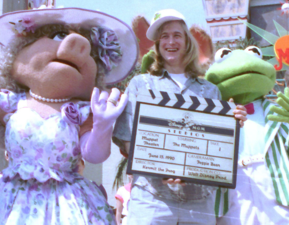 John Henson, son of the late Muppets creator Jim Henson, is seen with Muppets Miss Piggy and Kermit at the Disney/MGM studios in Lake Buena Vista, Fla., in 1990.