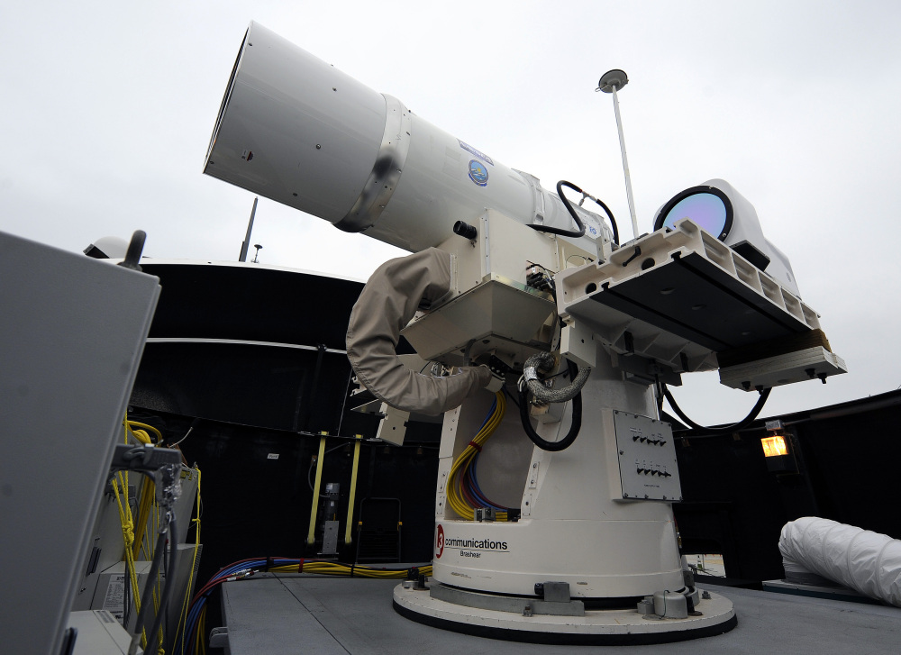A laser weapon sits temporarily installed aboard the guided-missile destroyer USS Dewey in San Diego.