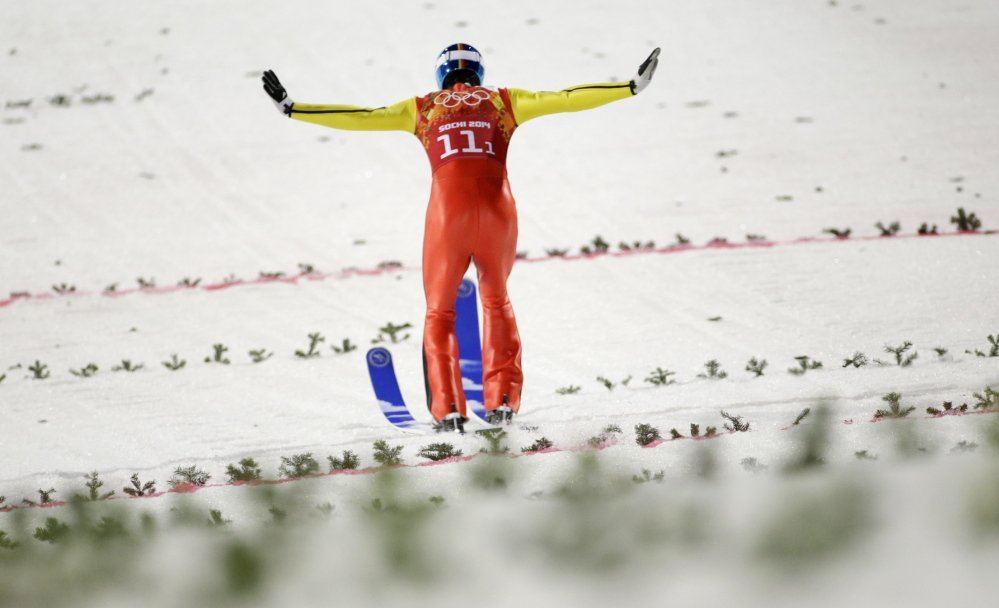 Germany's Andreas Wank lands his second attempt during the ski jumping large hill team competition at the 2014 Winter Olympics on Monday in Krasnaya Polyana, Russia.
