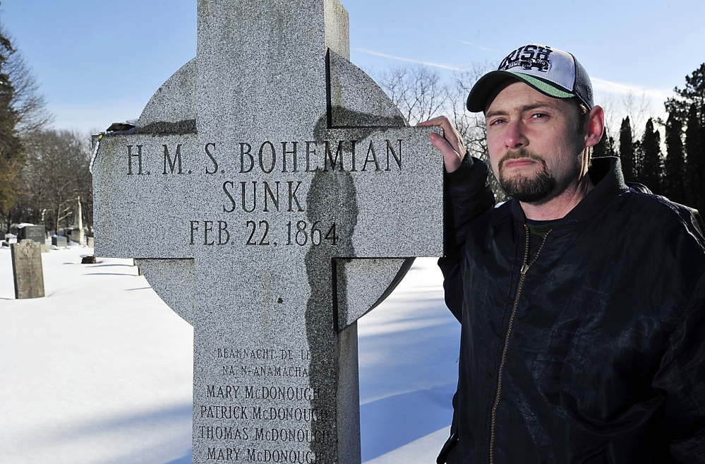 "Historian Matthew Jude Barker stands with the Celtic cross honoring victims of the RMS Bohemian shipwreck – ""HMS"" was an error, he said – in South Portland's Calvary Cemetery."