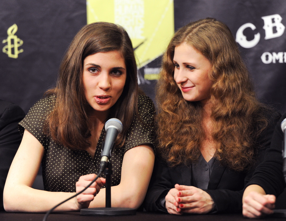 """In this Feb. 5, 2014, photo, Nadezhda Tolokonnikova, left, and Maria Alekhina of Pussy Riot, participate in a press conference for Amnesty International's """"Bringing Human Rights Home"""" concert at the Barclays Center in New York."""