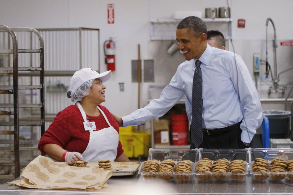 President Barack Obama talks with Dora Martinez, a baker at a Costco store in Lanham, Md., on Jan. 29, 2014, before his State of the Union speech in which he advocated raising the minimum wage.