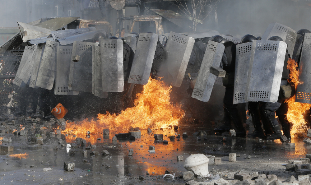 Riot police clash with anti-government protesters outside Ukraine's parliament in Kiev, Ukraine, on Tuesday. Some thousands of anti-government protesters clashed with police in a new eruption of violence Tuesday.