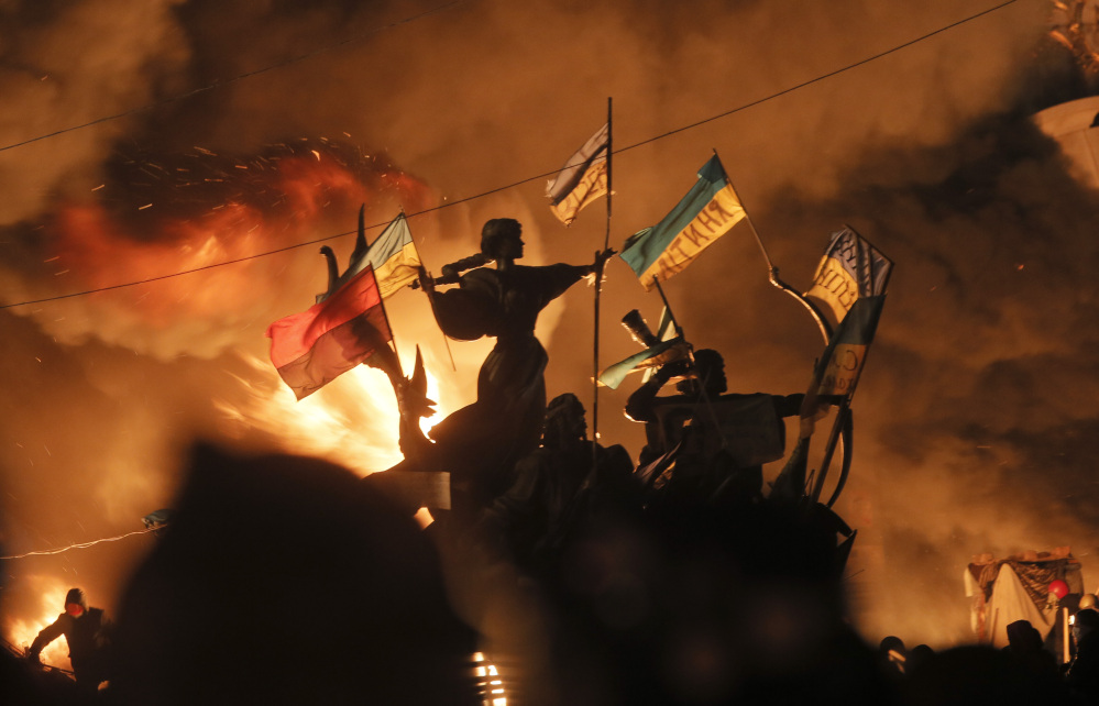Monuments to Kiev's founders burn as anti-government protesters clash with riot police in Kiev's Independence Square, the epicenter of the country's current unrest, on Tuesday.