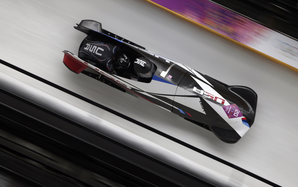 The team from the United States USA-1, piloted by Elana Meyers with brakeman Lauryn Williams, speed down the track during the women's two-man bobsled competition at the 2014 Winter Olympics, Tuesday, Feb. 18, 2014, in Krasnaya Polyana, Russia.