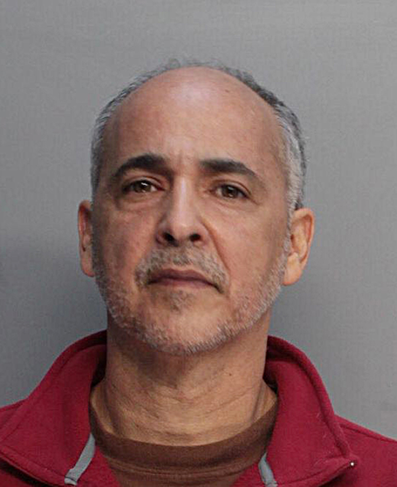 A police booking mug made available by the Miami Dade Corrections and Rehabilitation Deptartment shows artist Maximo Caminero, who is charged with criminal mischief.