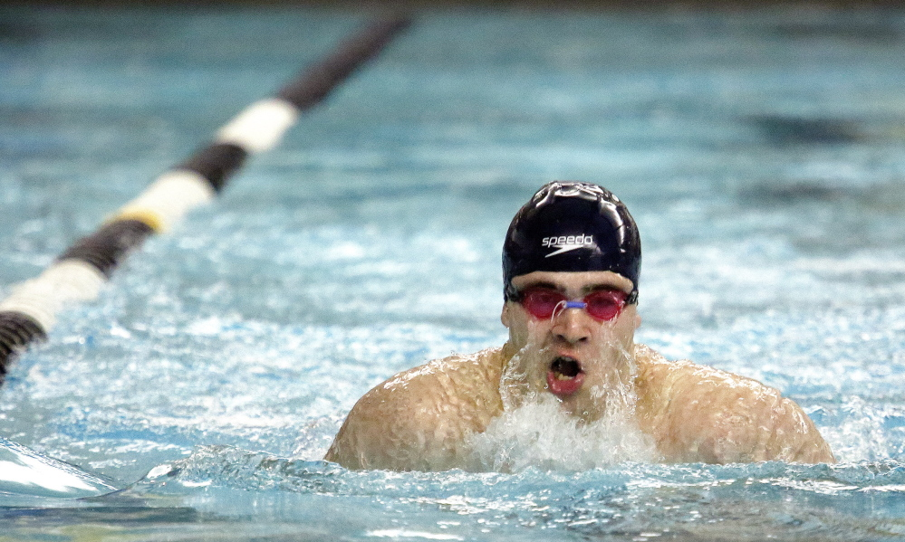 Griffin Fluet of Greely surfaces for air during the 100-yard breast stroke. Fluet finished fourth, helping Greely win its fifth straight team championship.
