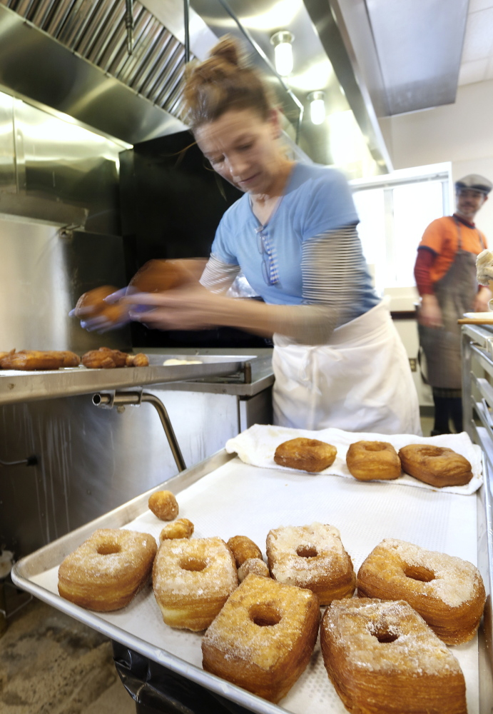 Plunkett in the kitchen at Little Bigs. She has been making the crauxnut, her adaptation of the wildly popular Cronut created by New York chef Dominique Ansel, since early January.