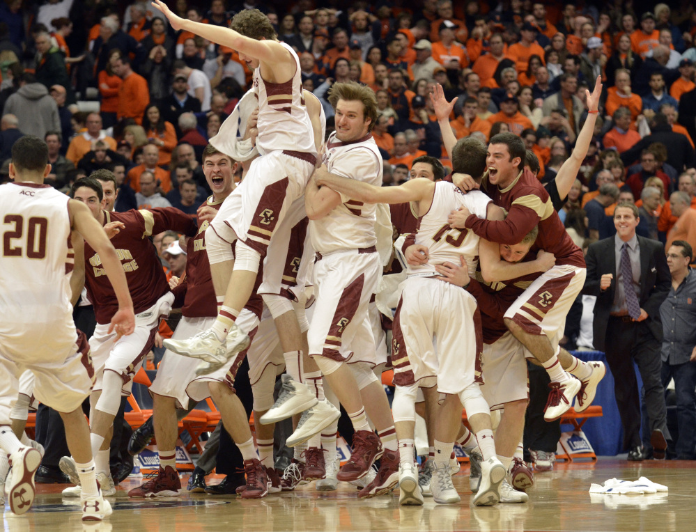 Boston College players celebrate after defeating Syracuse 62-59 in overtime in an NCAA college basketball game in Syracuse, N.Y., on Wednesday.