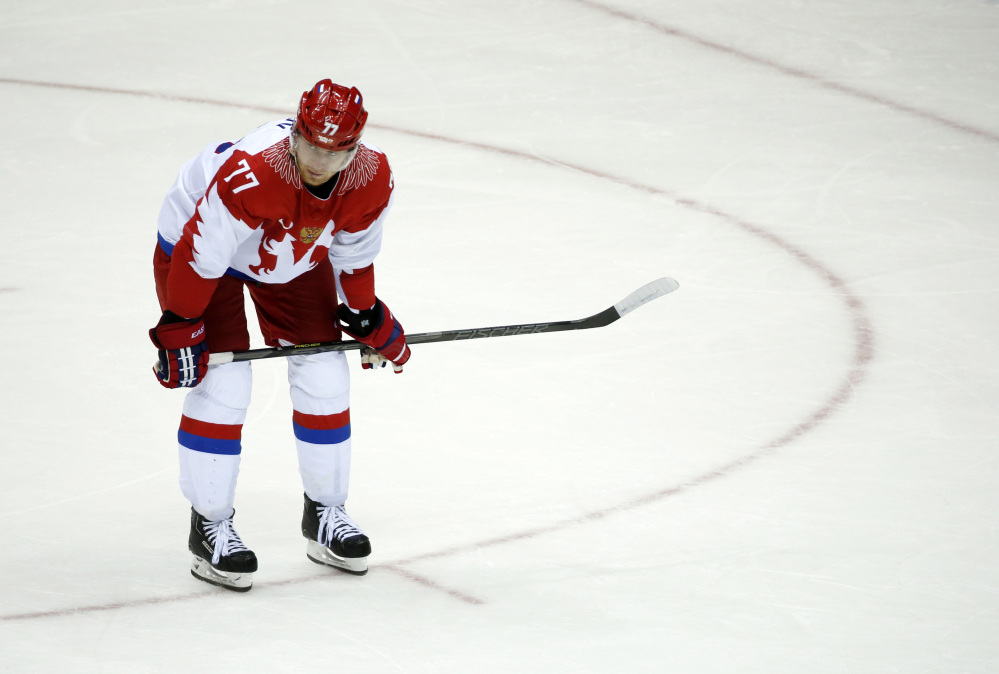 Russia defenseman Anton Belov reacts at the end of a men's quarterfinal ice hockey game against Russia at the 2014 Winter Olympics, Wednesday, Feb. 19, 2014, in Sochi, Russia. Finland won 3-1.