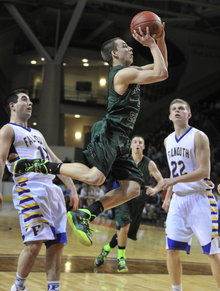 Dustin Cole of Bonny Eagle sails to the basket in front of Falmouth's Tom Coyne, left, and Jack Simonds during their Western Class A boys' basketball semifinal Wednesday night at the Cumberland County Civic Center. Cole scored 22 points, including 17 in the fourth quarter, to lead the Scots to a 62-61 win.