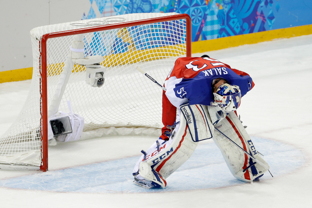 Czech Republic goaltender Alexander Salak looks down at the ice after the team's 5-2 loss to the United States in the men's quarterfinal hockey game in Shayba Arena at the 2014 Winter Olympics on Wednesday in Sochi, Russia.
