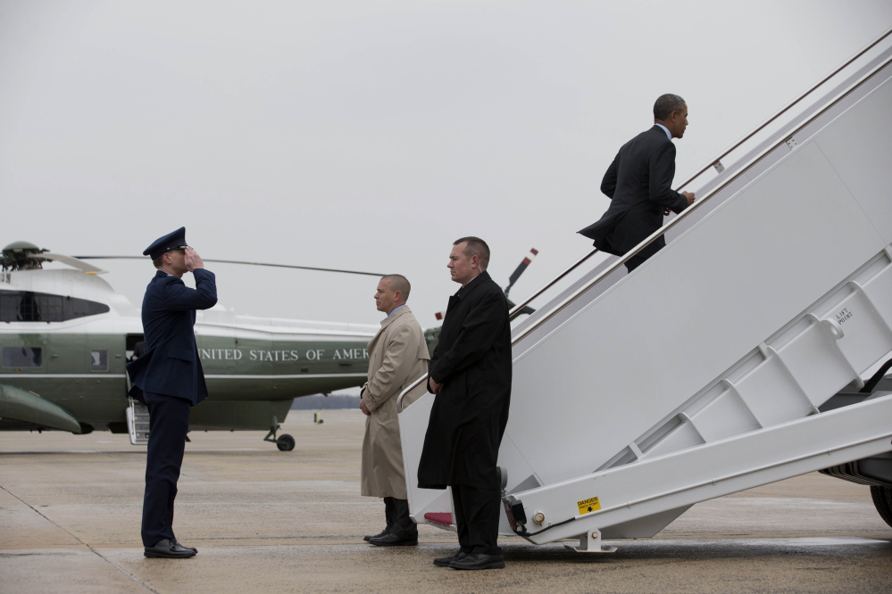 President Barack Obama boards Air Force One at Andrews Air Force Base, Md., on Wednesday prior to traveling to Toluca, Mexico, to meet with Canadian Prime Minister Stephen Harper and Mexican President Enrique Pena Nieto.