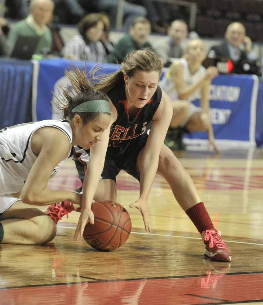Vanesa Barnes, left, of Spruce Mountain and Stephanie Woods of Wells dive for a loose ball Thursday during their Western Class B girls' basketball semifinal at the Cumberland County Civic Center. Wells eliminated Spruce Mountain for the second straight year, 55-31.