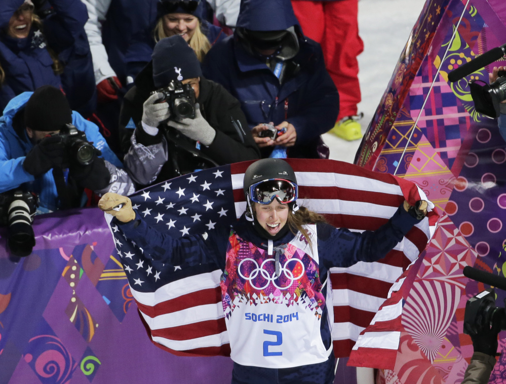 Maddie Bowman of the United States celebrates after winning the gold medal in the women's ski halfpipe final at the Rosa Khutor Extreme Park, at the 2014 Winter Olympics Thursday in Krasnaya Polyana, Russia.