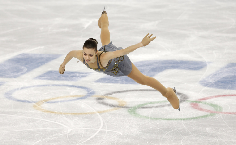 Adelina Sotnikova of Russia competes in the women's free skate figure skating finals at the Iceberg Skating Palace during the 2014 Winter Olympics, Thursday, Feb. 20, 2014, in Sochi, Russia.