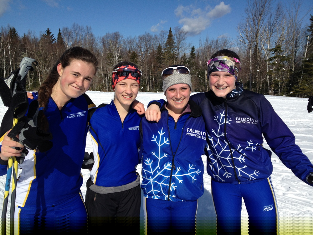 Lucy Mahoney, left, London Bernier, Anna Morin and Gabby Farrell of Falmouth celebrate their girls' Class A Nordic skiing championship Thursday at the Rangeley Lakes Trail Center.