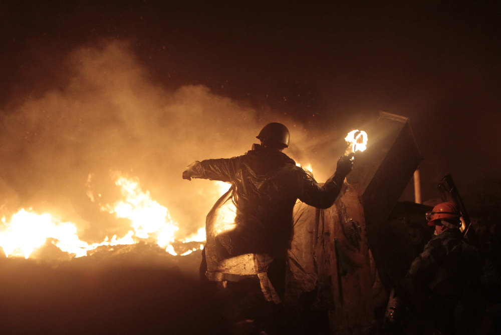 Anti-government protesters clash with riot police in Kiev's Independence Square, the epicenter of the country's current unrest, in Ukraine, Thursday.