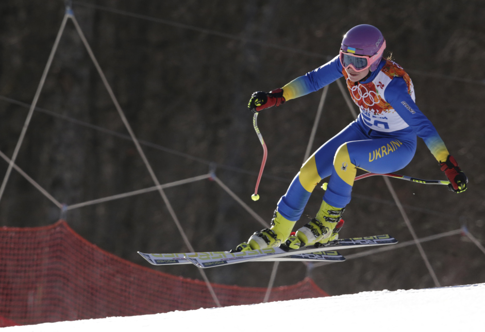 In this Saturday, Feb. 15, 2014 photo, Ukraine's Bogdana Matsotska makes a jump in the women's super-G at the Sochi 2014 Winter Olympics in Krasnaya Polyana, Russia. The International Olympic Committee said on Thursday, Feb. 20, that Matsotska has left the Olympics in response to the violence in her country.