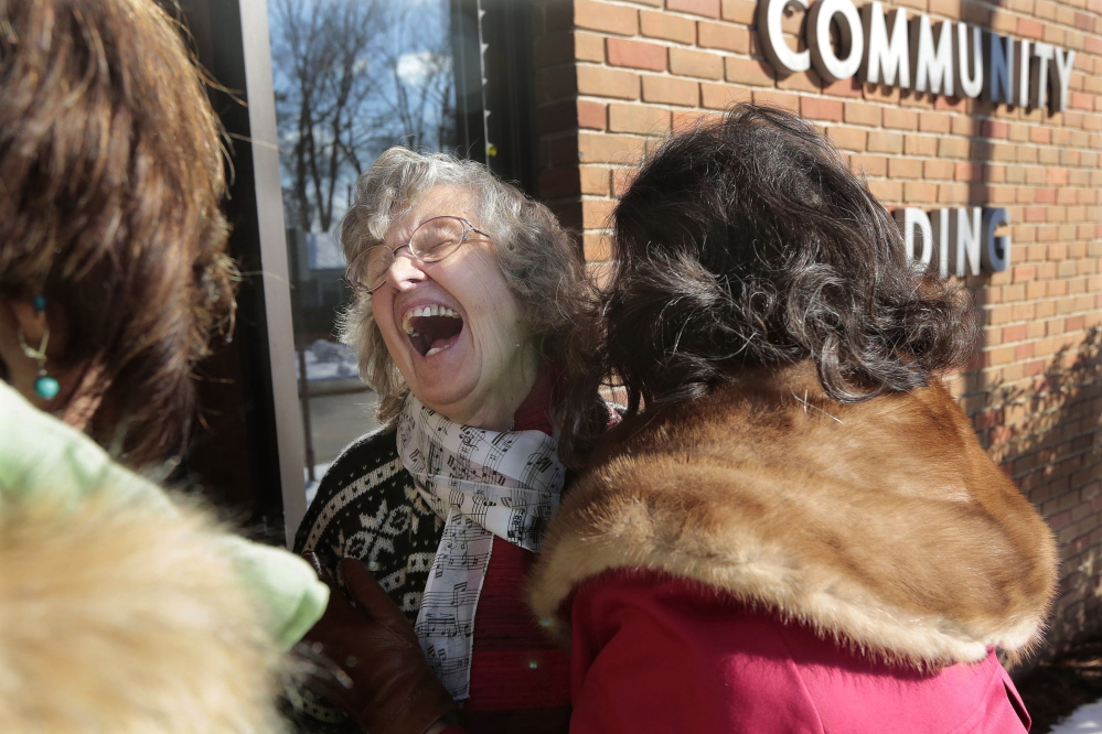 Helen Fisher, 80, laughs as she meets her nieces Barbara Garro of Saratoga Springs, N.Y., and Jean Carl of Exton, Pa., on Feb. 10 for the first time at the McGann Terrace Community Center in Fairhaven, Mass.