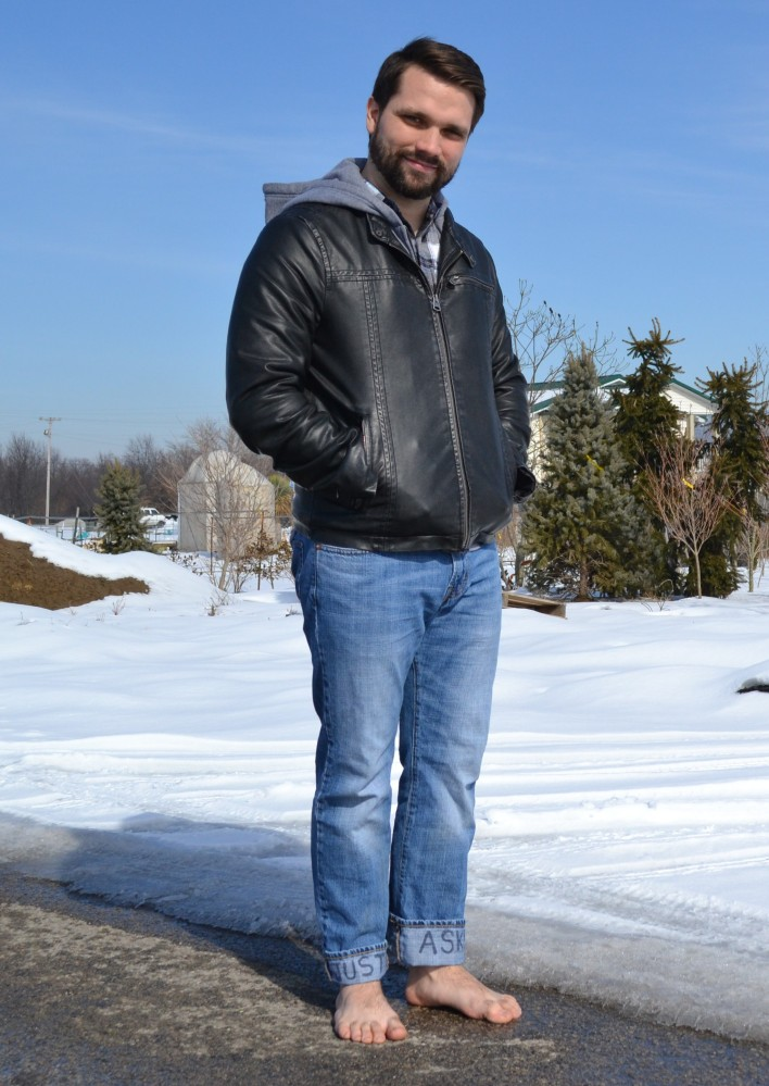 Richard Hudgins stands barefoot near snow in Louisville, Ky., on Feb. 12.