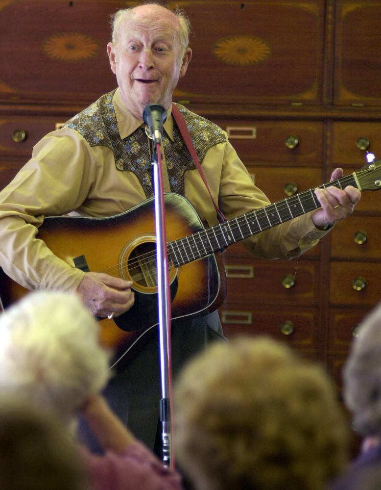 2001 FILE PHOTO by Gregory Rec/Staff Photographer: On Friday, Feb. 2, 2001, Red Soucy launches into a song after telling a joke while performing at Dyer Library in Saco. His group, the Saco Troubadours, includes Roland J. Bergeron and Ray Laflamme.