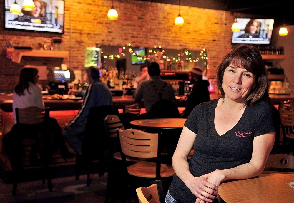 Tina Charest describes how she fell victim to a scammer who called about the power bill for her business at Charlamagne's Bar & Lounge on Water Street in Augusta on Friday.