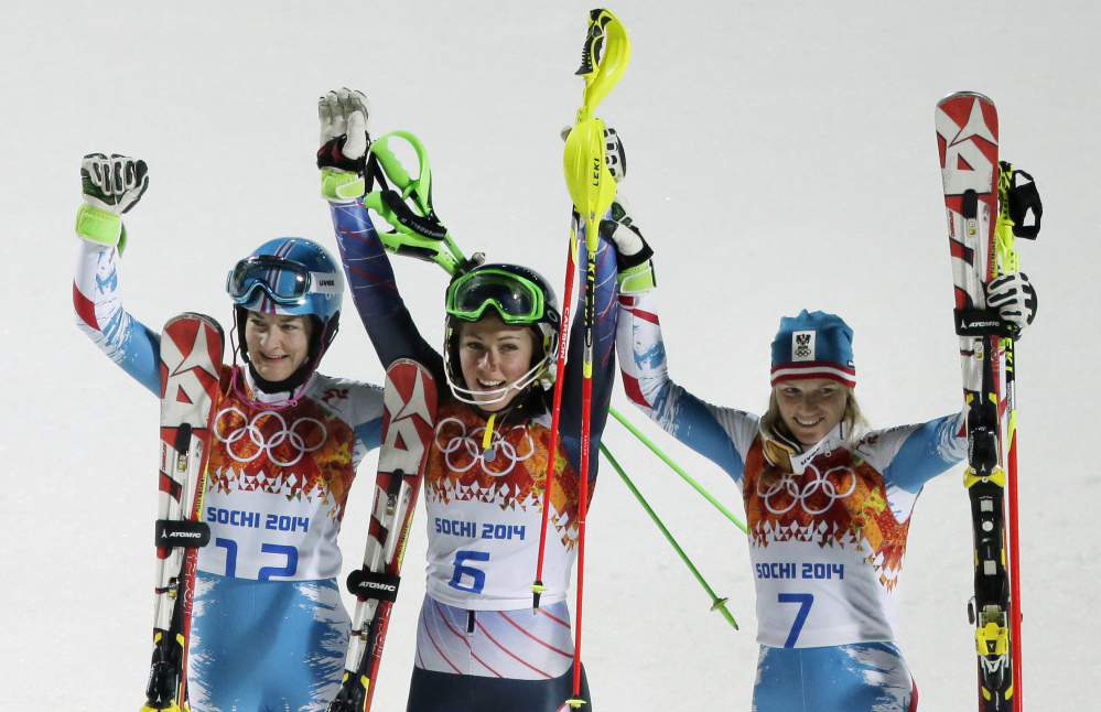 The Associated Press Women's slalom medalists, from left, Austria's Marlies Schild (silver), United States' Mikaela Shiffrin (gold), and Kathrin Zettel (bronze) celebrate at the Sochi 2014 Winter Olympics.