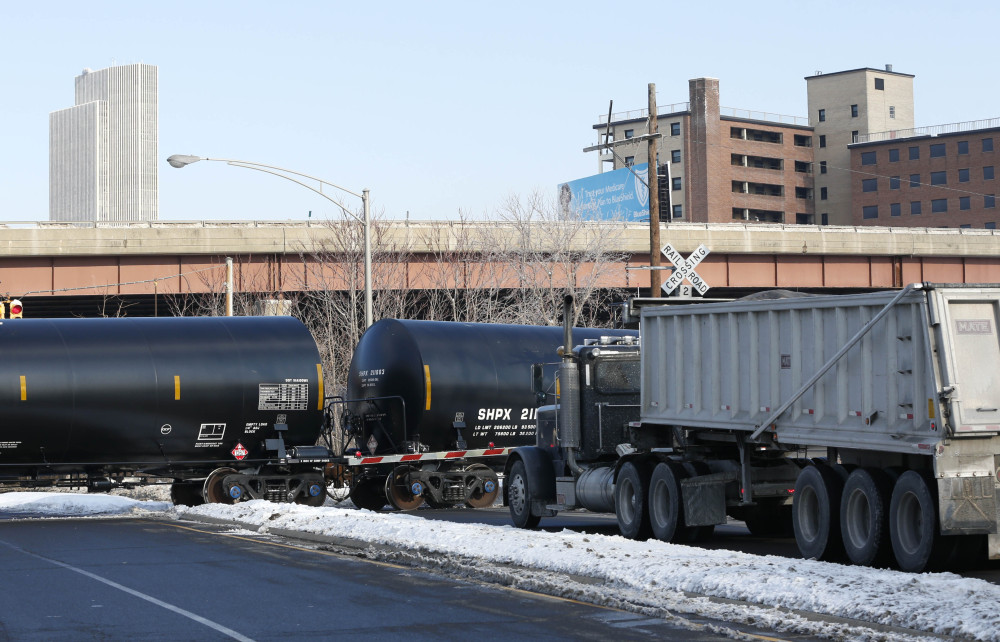 A truck waits as railroad oil tanker cars arrive at the Port of Albany recently. The Port of Albany has become a hub for the U.S. oil business, taking shipments from North Dakota's Bakken Shale daily by mile-long trains and shipping it in tankers down the Hudson River to refineries.